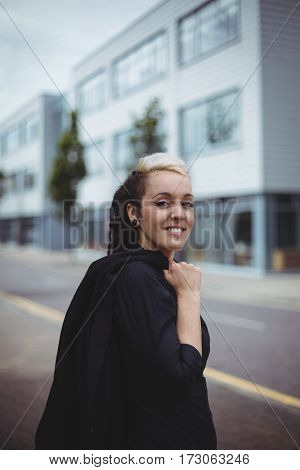 Portrait of smiling businesswoman standing in office campus