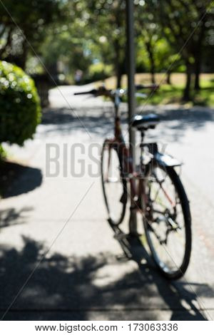 Blur view of bicycle parked in a park on a sunny day