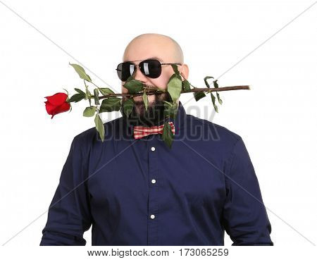 Bearded fat man with flower in mouth on white background