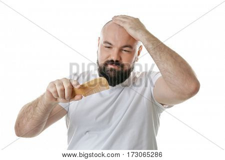 Bald adult man with comb on white background