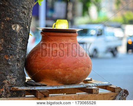 Clay Pot With Water For Drinking On Street