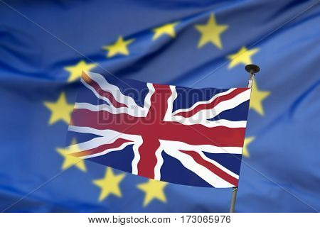 The British flag with the European flag in the background