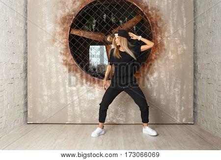 Street dance girl dancer on textured background