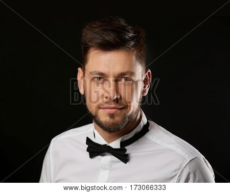 Handsome young man posing on dark background