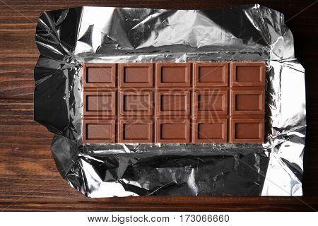Chocolate bar on foil, closeup