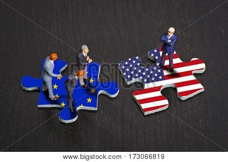 Puzzle pieces with the flags of Europe and the USA