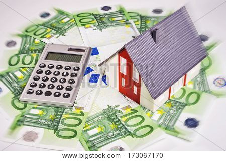 A house is surrounded by euro money.