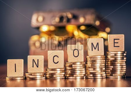 Stack of coins and the word income