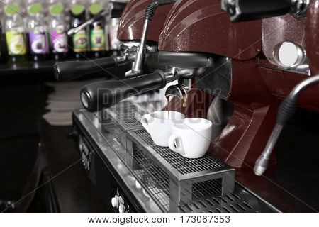 Coffee machine with cups, closeup