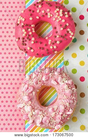 Delicious donuts on colorful background