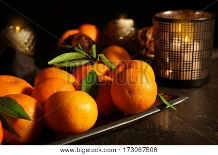 Christmas composition with tangerines and candles