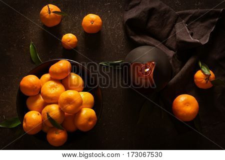 Tangerine in plate with candle on table