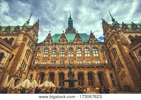 HAMBURG GERMANY - JUNE 10: Beautiful view of famous Hamburg town hall with Hygieia fountain from courtyard near market square and lake Binnenalster in Altstadt quarter in 2012