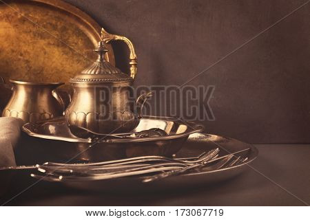 Set of vintage tableware on gray background