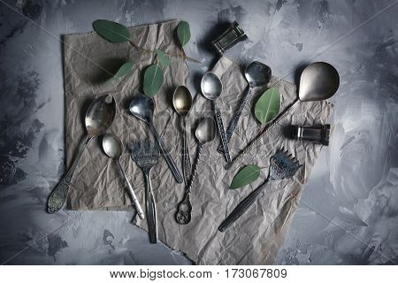 Set of silverware on grey background