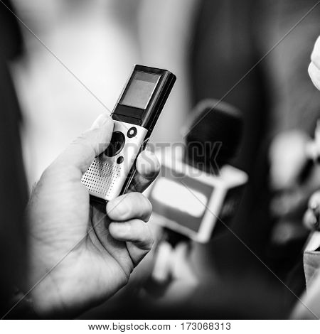 interviewing businessman , black and white image, close up