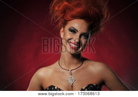 red hair girl model at the black background