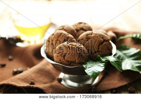 Bowl with coffee cookies on brown napkin