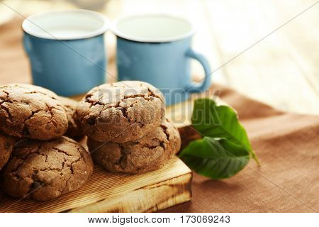 Delicious coffee cookies on wooden board