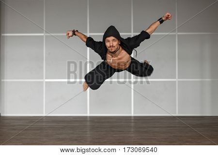 Male dancer jumping in the air. Dance