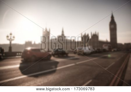 blurred background of traffic on Westminster Bridge with typical English cabs and buses