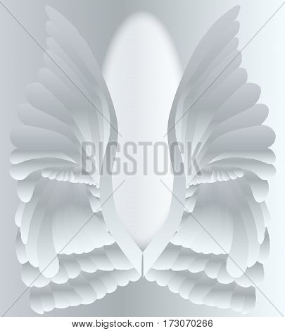 A large pair of silver angelic style wings.