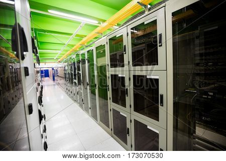 Hallway with a row of servers in server room