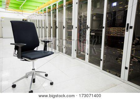 Empty chair in corridor of server room
