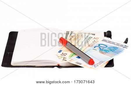 Heap of dollars and euro on notepad isolated on a white background