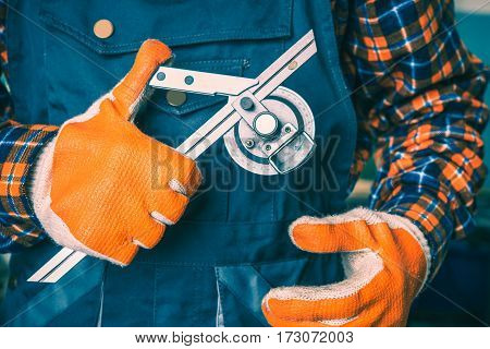 Professional Measuring Tool in Hands of Worker.