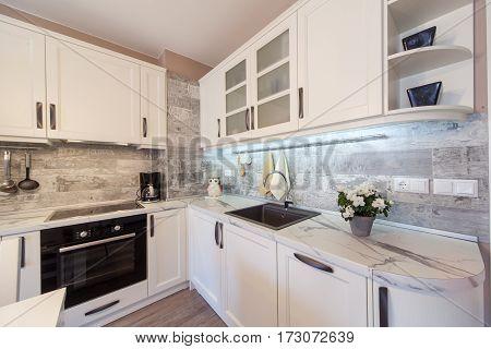 Modern white kitchen interior. Home interior photography.