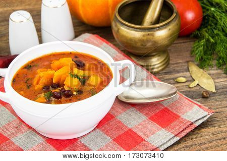 Spicy vegetable soup with red beans and pumpkin. Studio Photo