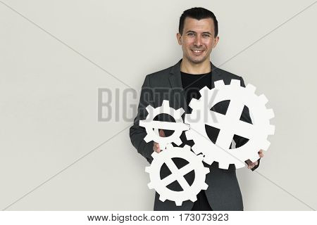 Businessman Smiling Happiness Holding Gear Symbol Concept