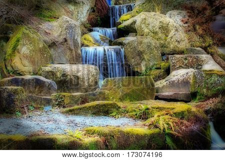A mystical waterfall with an Horton effect and vignette border added.