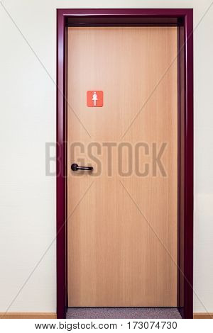 public bathroom door with sign for women