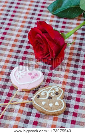 Oatmeal Cookies In The Shape Of A Heart With Red Rose