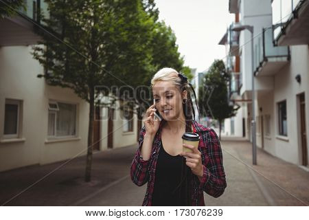 Woman talking on mobile phone in street