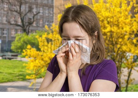 Allergy Concept. Young Allergic Woman Is Sneezing And Blowing He