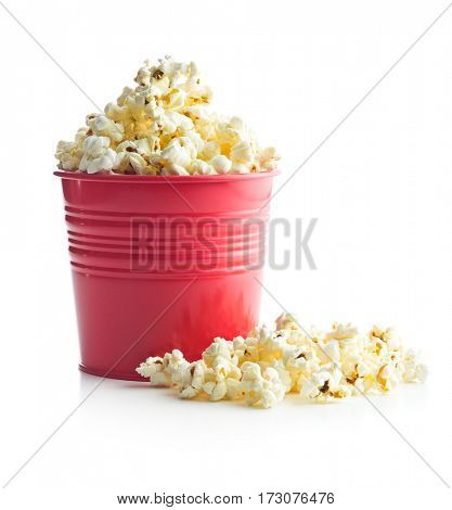Tasty popcorn in red cup isolated on white background.