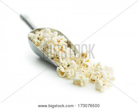 Tasty popcorn in metal scoop isolated on white background.