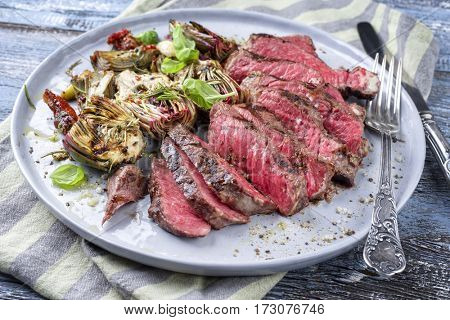Barbecue Kobe Point Steak with Artichoke Hearts on Plate