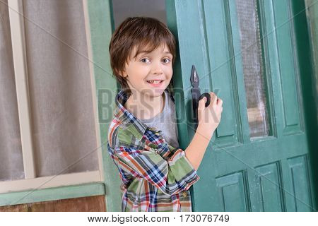 excited boy standing in door and looking to camera