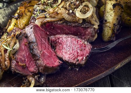 Kobe Rib Eye Steak very rare with fried Onion and Potatoes