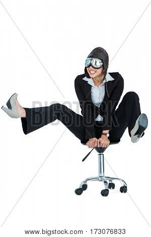 Businesswoman wearing aviator glasses sitting on office chair against white background