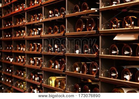 Shelving with wine bottles in winery shop
