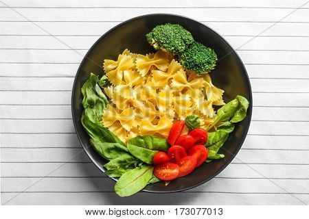 Pasta with food ingredients in plate  on  table