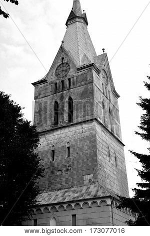 Tower of the fortified medieval church in Bunesti, Transylvania, Romania.