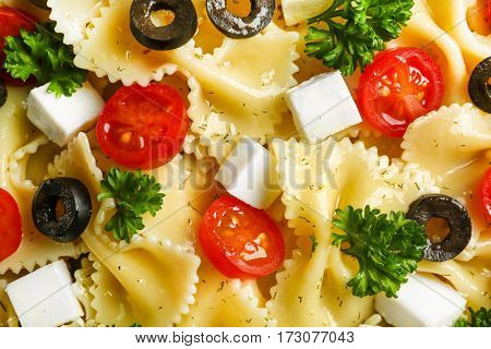 Pasta salad with tomatoes and cheese, closeup