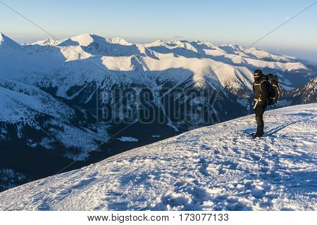 Hiker With Backpack On The Background Of A Mountain Landscape.