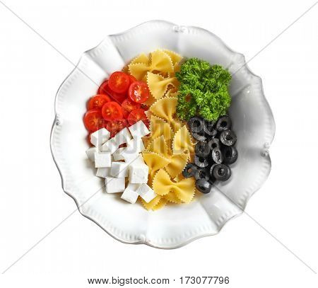 Pasta with ingredients in plate on white background